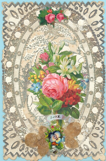 An image of a Victorian Valentines card held in the collection at the Museum of Norwich. It shows a bouquet of flowers on a lace background, with a small banner that reads 'love'.