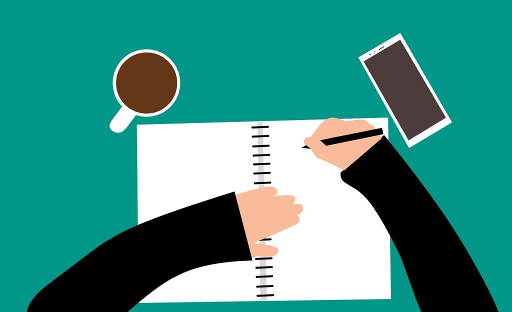 an illustration to represent a birds eye view of a person writing at their desk. A hand holding a pen, writing in a notebook, with a mobile phone and a mug of coffee