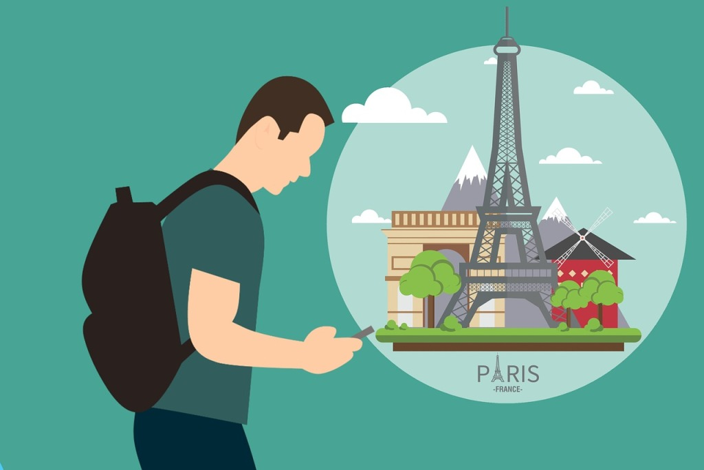 Male walker planning his trip to Paris and all the landmarks he will see, including the Eiffel Tower.
