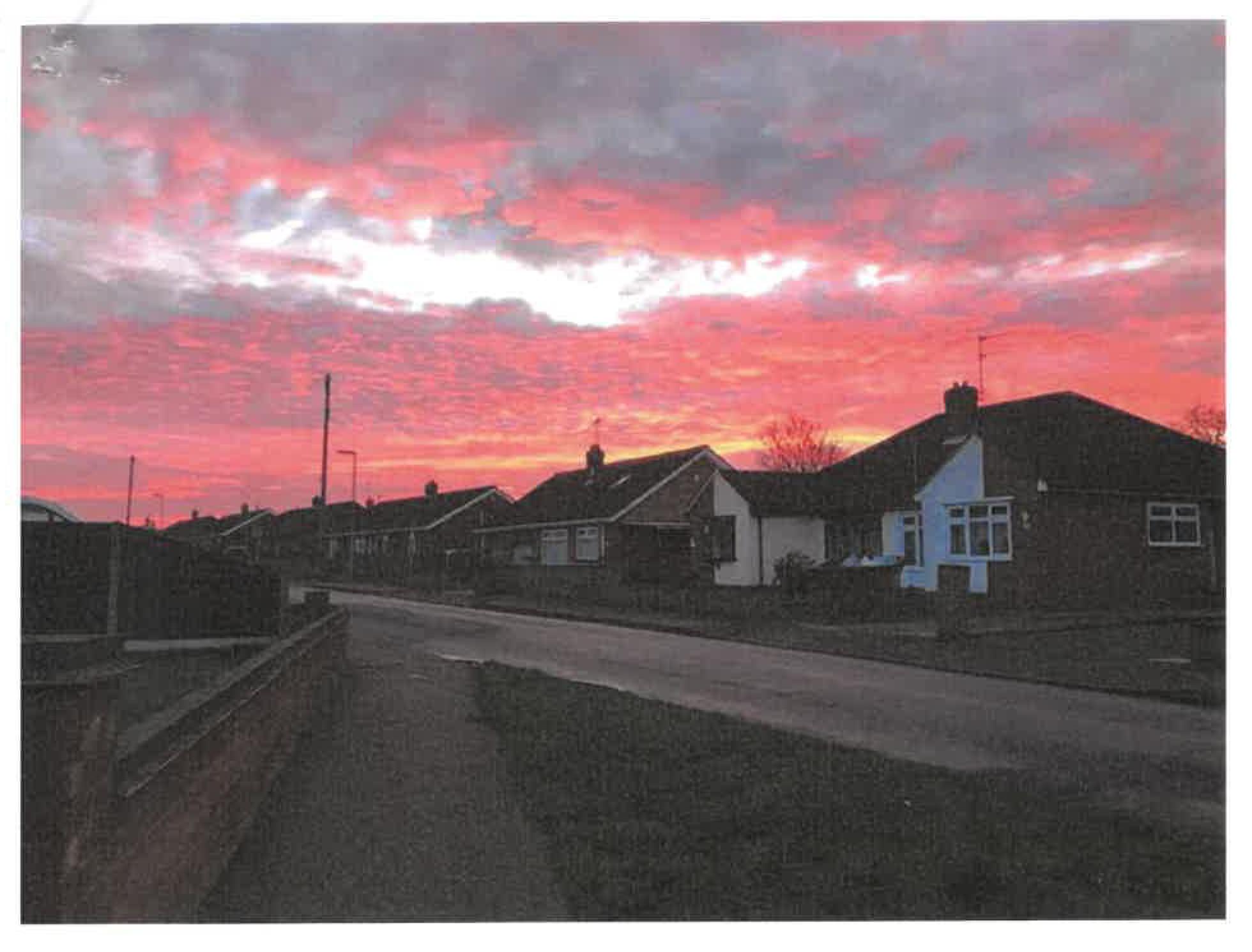 photograph of a neighbourhood at sunset